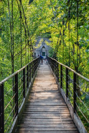 Man on old bridge of Ubiale Clanezzo in the Province of Bergamo in the Italian region of Lombardy