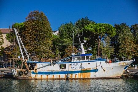 Old boat in harbour of Rimini city, Italy