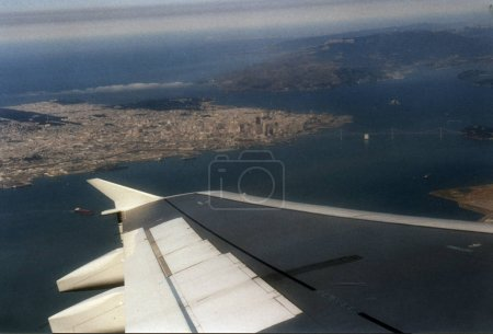 airplane flying over  San Francisco
