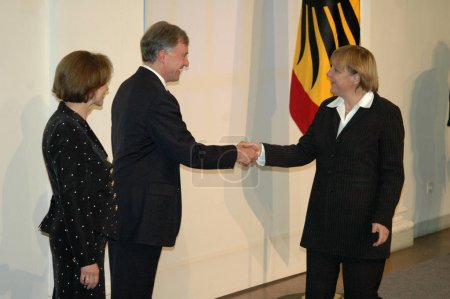 German President Horst Koehler with his wife welcome Angela Merkel