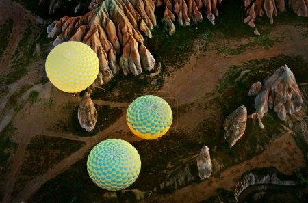 Hot air balloons over mountain landscape