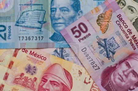 Different Mexican money background.