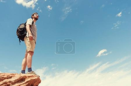 Hiker in mountains against sky