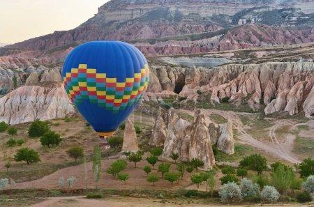 Morning flight of the hot air balloon above mountain landscape in Cappadocia,Turkey.