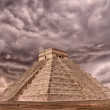 Ancient Pyramid in Chichen Itza against a dramatic...