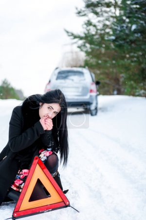 portrait of a beautiful young girl, whose car broke down in the