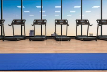 Photo pour Tapis de yoga bleu rendu 3d dans la salle de fitness - image libre de droit