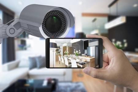 Photo pour Main tenant 3d rendu mobile connect avec caméra de sécurité - image libre de droit