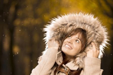 woman in autumn coat enjoying the rain