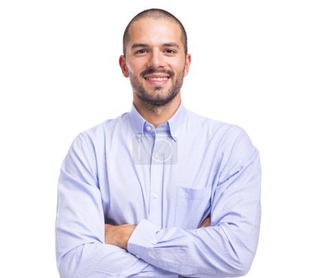 Photo for Handsome smiling young man with arms crossed on a white background - Royalty Free Image