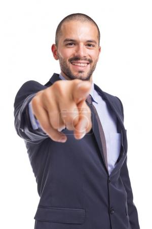 Handsome businessman pointing the finger at you