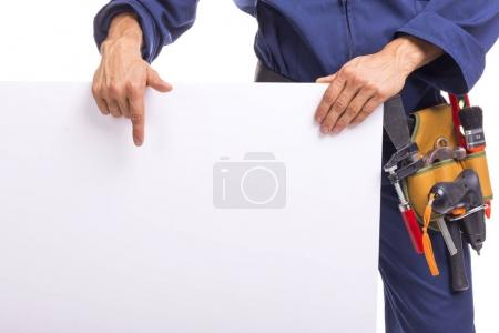 Closeup of a worker pointing to a white board