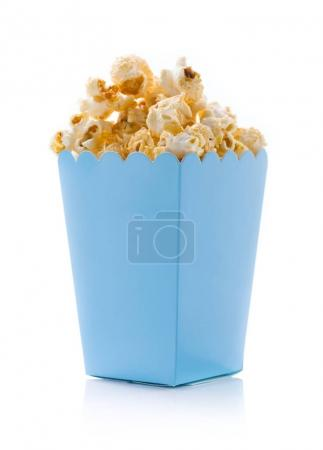 Popcorn in blue bucket, isolated on white background