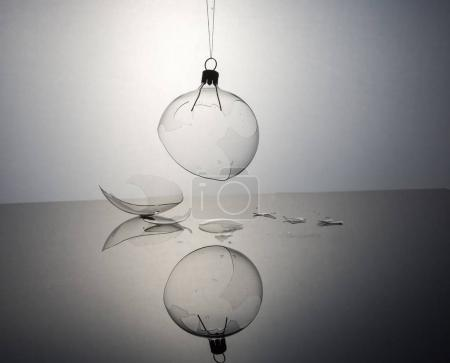 A shattered glass christmas ball on a white background