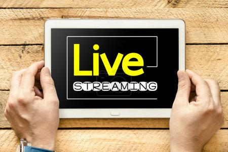 Live streaming on tablet screen in hands