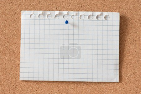 piece of graph paper with pushpin