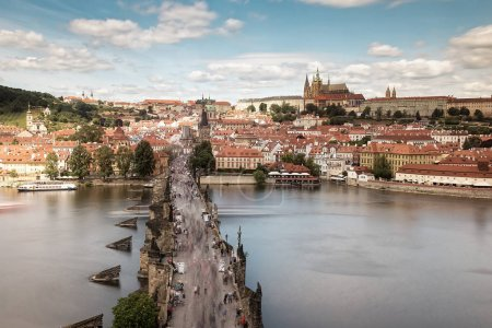 Prague with red roofs and Charles bridge
