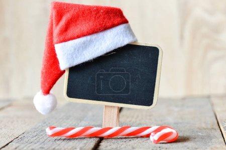 santas hat on small blackboard