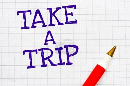 take a trip writing on note book