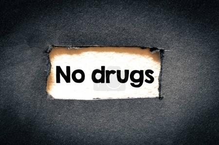 no drugs  sign on black background