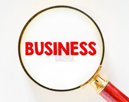 business red sign and magnifying glass