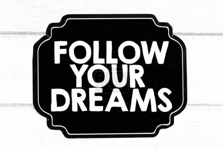 follow your dreams sign black and white