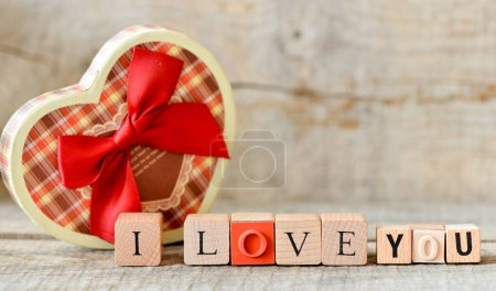 box made in heart shape on wooden background