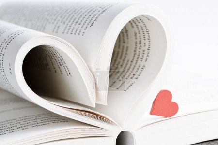 Opened book with heart form sheets