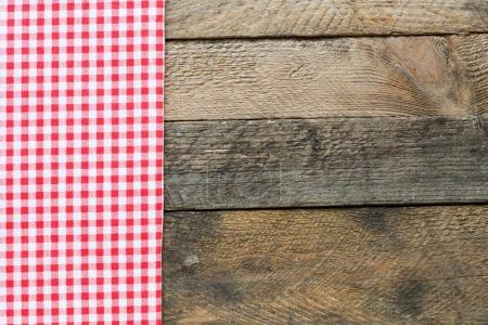 Rustic wooden background with a red table cloth