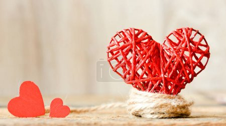 Hearts on a wooden background. Background in the style of Valentine's Day