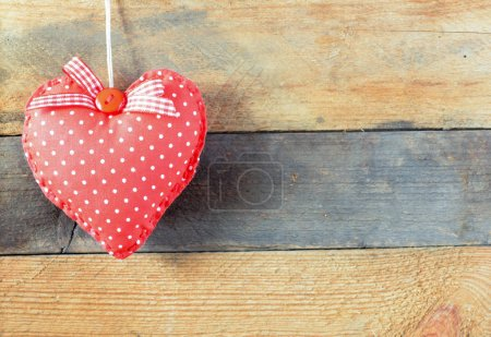 Heart on a wooden background. Background in the style of Valentine's Day. Heart on a wooden background