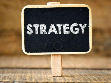 Strategy. Business concept on blackboard on wooden background