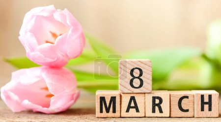 wooden Blocks with text 8 march and tulips on background, international women day concept