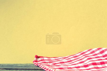 red and white checkered tablecloth on wooden background