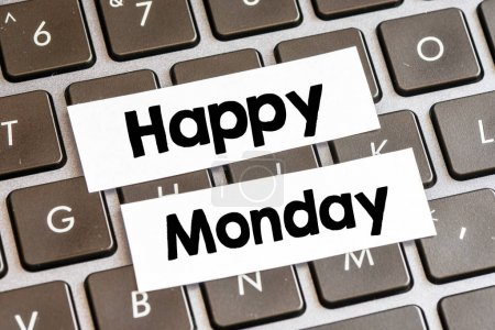 Photo for Closeup of laptop keyboard buttons with symbols and text Happy Monday - Royalty Free Image