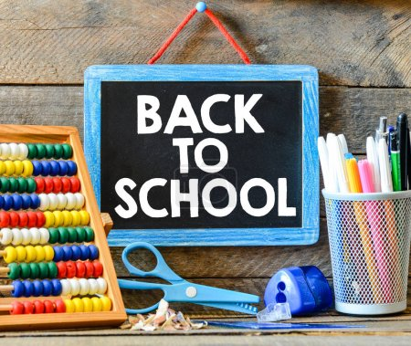 Back to school inscription on chalkboard text concept
