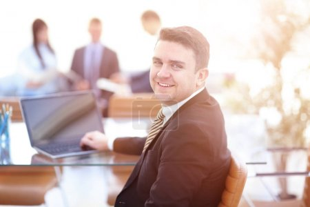 Photo for Handsome businessman working with laptop in modern office - Royalty Free Image