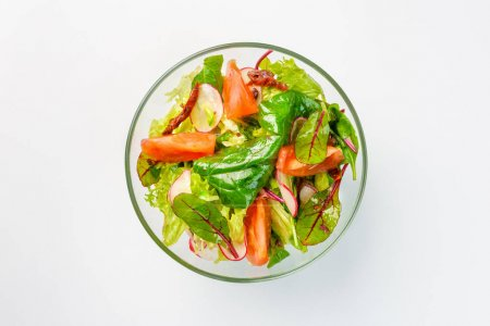 Photo for Lenten salad with lettuce, radishes and tomatoes. White background - Royalty Free Image