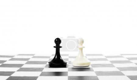 Two pawns one in front of other. Equal rivals