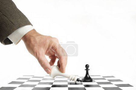 Man surrenders in chess game. Concept of losing and failure