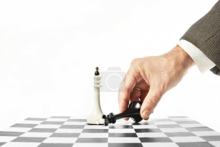 Man surrenders in chess game. Concept of defeat and failure