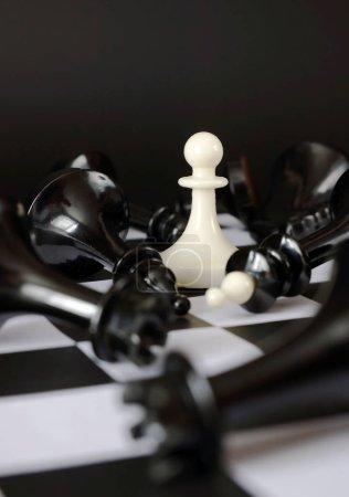 Pawn between fallen enemies. Winner and total victory