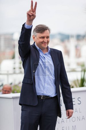 CANNES, FRANCE - MAY 09, 2018: Director Sergey Loznitsa giving peace sign, attending photocall for 'Donbass' during the 71st annual Cannes Film Festival at Palais des Festivals
