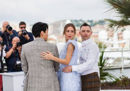 CANNES, FRANCE - MAY 9, 2018: Actors Teo Yoo, Roman Bilyk, Irina Starshenbaum attending screening of 'Leto' during the 71st annual Cannes Film Festival at Palais des Festivals