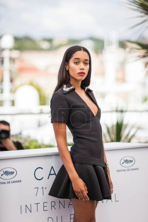 CANNES, FRANCE - MAY 15,  2018: Laura Harrier wearing black dress attends the photocall for the 'Blackkklansman' during the 71st annual Cannes Film Festival
