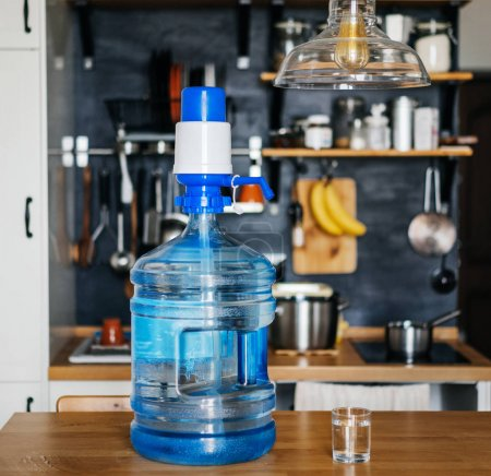 Bottle of clean water 19 liters with blue pomp in ...