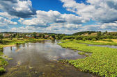 Beautiful rural landscape with river and clouds
