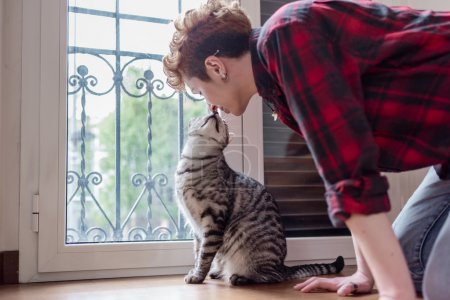woman and her european cat