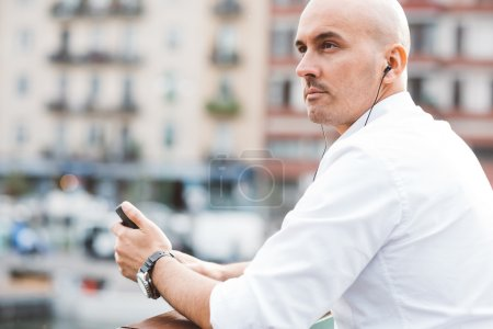 businessman listening music with earphones