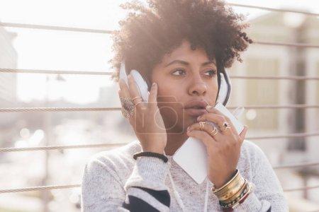 afro woman listening music